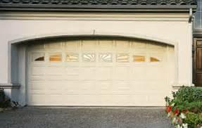 Dented Garage Door by Aluminum And Steel Garage Doors Are Becoming Standard In