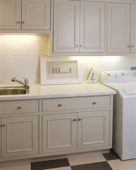 white cabinets for laundry room ivory laundry room cabinets design ideas