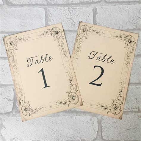 antique style wedding table numbers names cards shabby