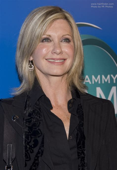 olivia newton john hairstyles olivia newton john wearing her hair in a medium hairstyle