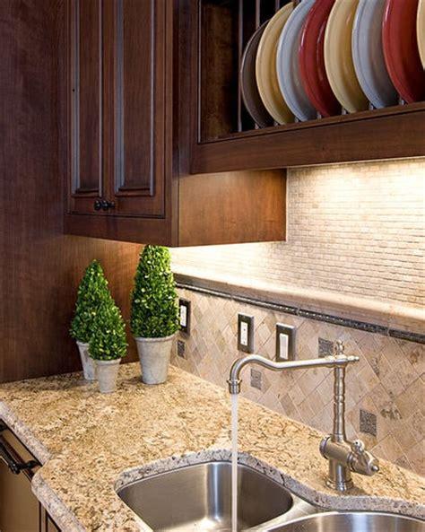 are backsplashes important in a kitchen kitchen details tumbled travertine backsplash traditional kitchen by in