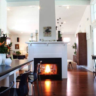 fireplace center speaker family room contemporary with see through center of room fireplaces free standing see