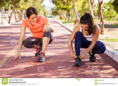 tying shoes before a run stock photo image of outdoor