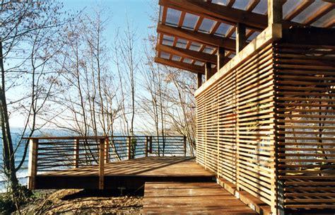 Slatted fence panels garage modern with wood siding