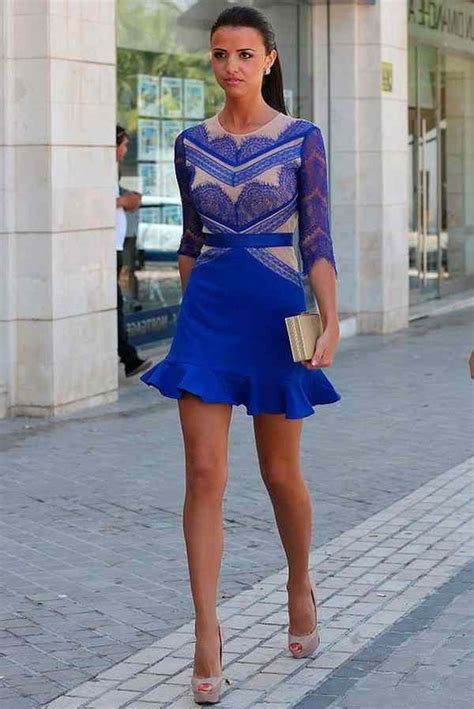 a in a cobalt blue dress with lace skirt and