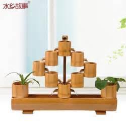 water story living room opening gifts lucky bamboo water ganpati decoration ideas for home the royale
