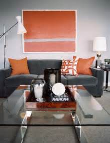 Gray and orange masculine bachelor style living room design ideas