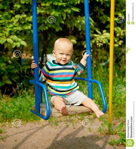 baby on a swing baby boy on a swing stock image image 32759361