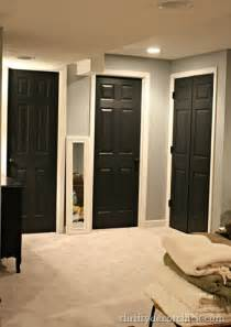 Black interior doors white trim through out house grey
