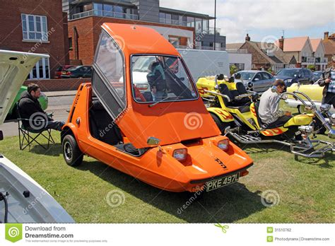 bright orange cars bond bug 850es car vintage editorial photography image