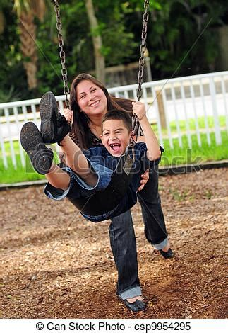 pushing a swing stock images of mom pushing son on swing young boy