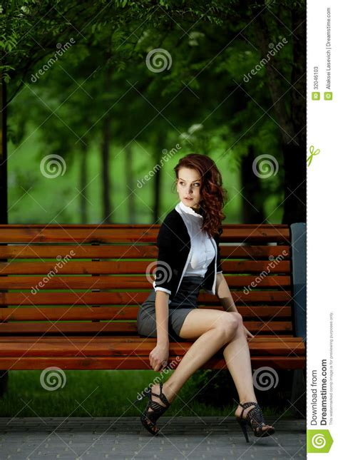 girl sitting on a bench beautiful girl sitting on bench stock photos image 32046103