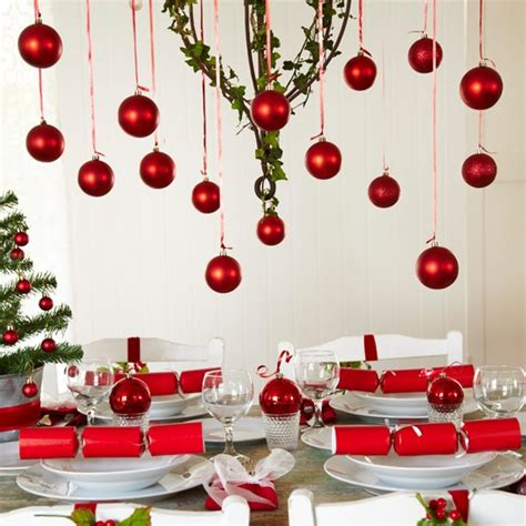 festive decoration company festive table setting with hanging red baubles christmas