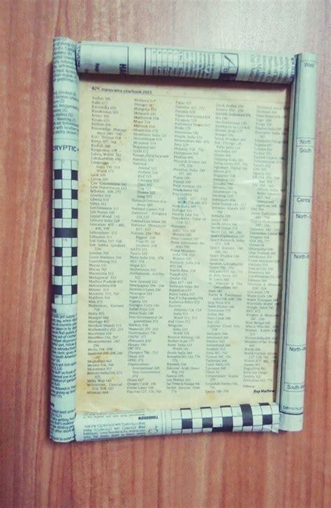 newspaper rolled frame  frame photo holder art