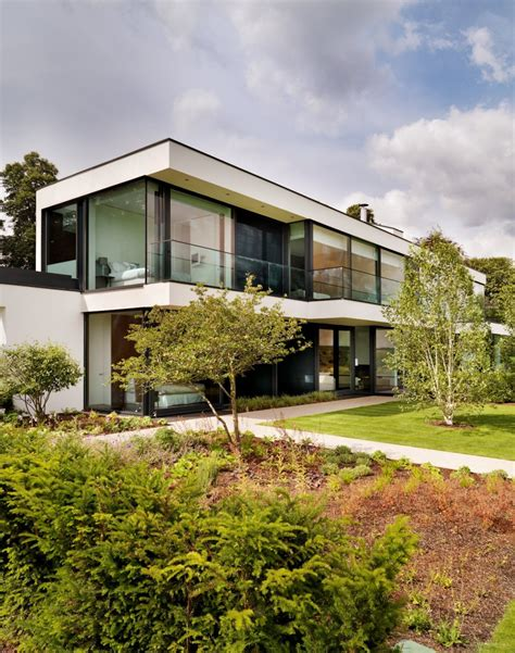 modern country home contemporary house in england built around an enclosed
