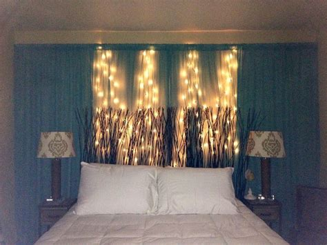 diy curtain string lights behind headboard on wall