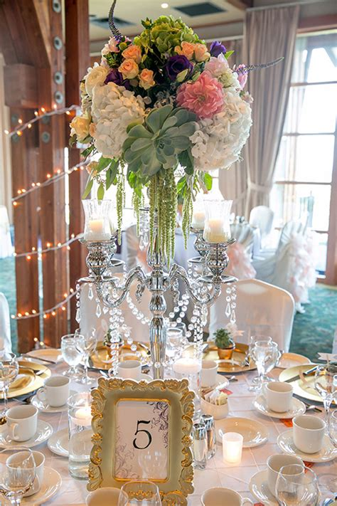 centerpiece for luxury wedding with a touch of botanical charm the