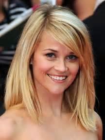 Haircuts for round face medium length hair