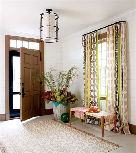 foyer window curtains love the curtains the doors home interiors lights