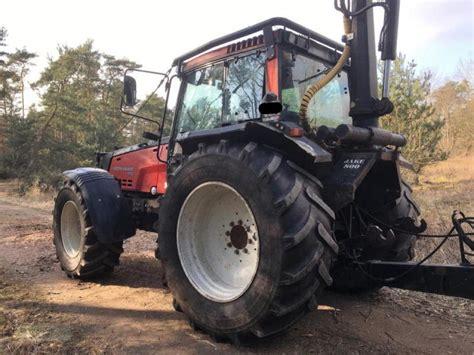 Kran Ina valtra 8750 mit forstausr 220 stung kran r 220 fa traktor 01920