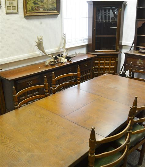 mid 20th century oak dining room table with eight leather a mid 20th century oak dining room suite comprising of a