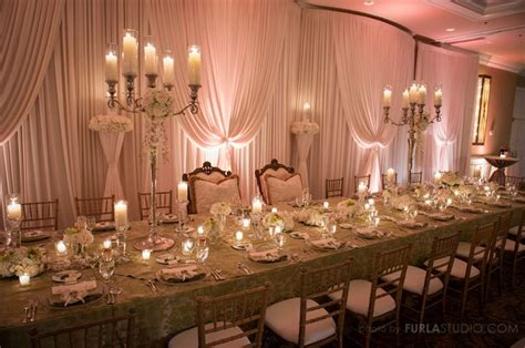 white table decoration with high candelabras