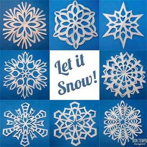 Make Fancy Paper Snowflakes - copos de nieve de papel bueno bonito y barato