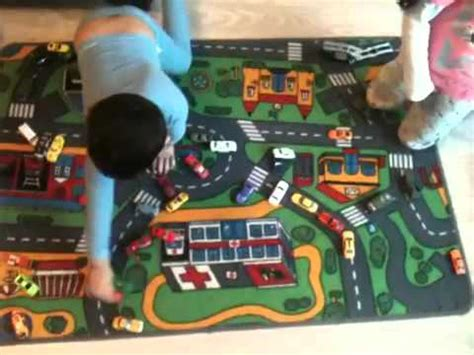 diecast cars on car play mat