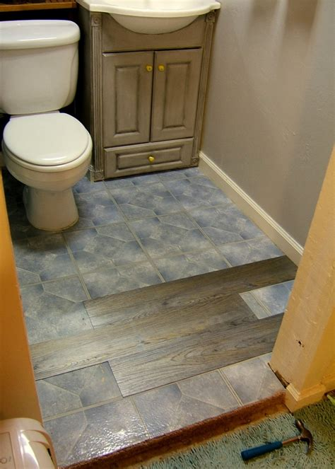 installing floating vinyl plank flooring over ceramic wall tiles for small and narrow bathroom