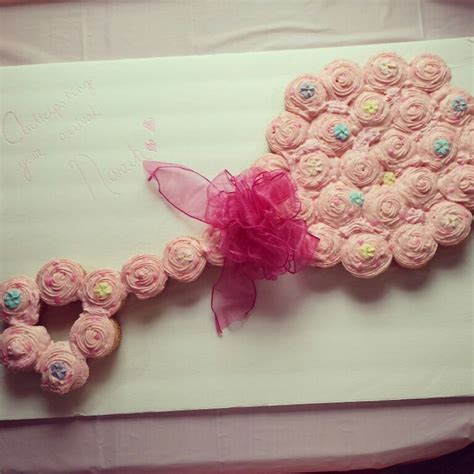 baby shower rattle cupcakes pink baby rattle cupcake cake for a baby shower my