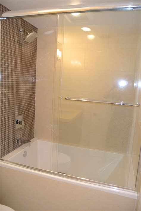 enclosed bathtubs large sliding glass door combined with silver steel towel