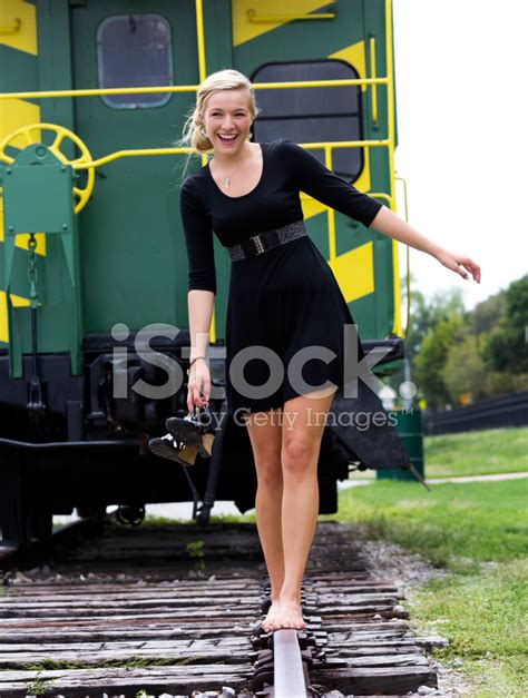 Concepts Of Home Design by Barefoot Walking On Railroad Tracks Stock Photos