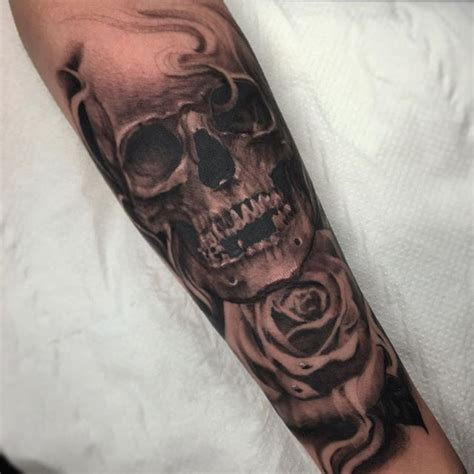 skull and rose sleeve tattoo skull and completed today on the inner forearm