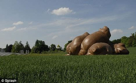 dog suddenly pooping in house runaway inflatable dog poop sculpture pic