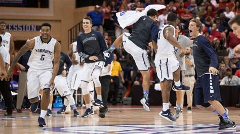 college basketball bench celebration nobody in sports is having as much fun as the monmouth bench