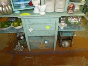 sewing cabinet repurposed into a kitchen island of