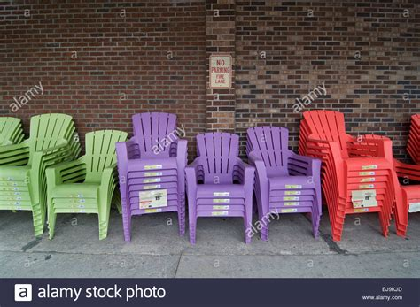 colorful plastic patio chairs multi colored plastic lawn chairs for sale lined up in a