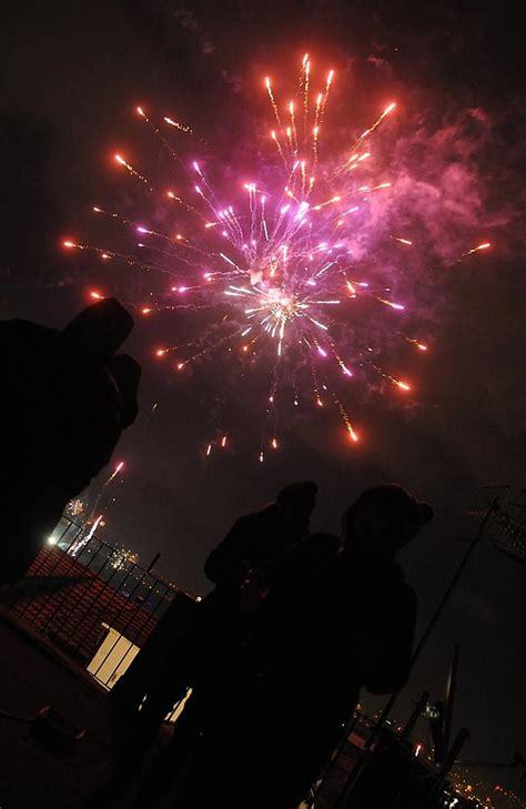 light firecrackers around the new year fireworks around the world light the for new year s