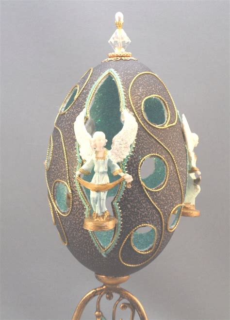 winged angels christmas ornament in emu egg renaissance angels