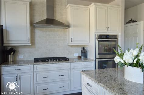 small white kitchen with steel hood white kitchen cabinets and stainless steel range hood