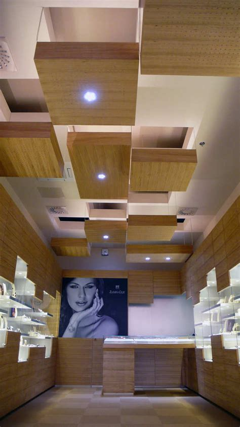 teori layout toko kayukuina desain interior toko perhiasan di slovakia oleh