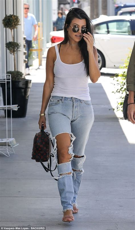 A Rip Off Kourtney Kardashian Shows Skin In Ripped Jeans