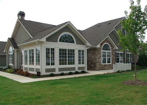 characteristics of a ranch style house one story house with tall entrance attached garage are