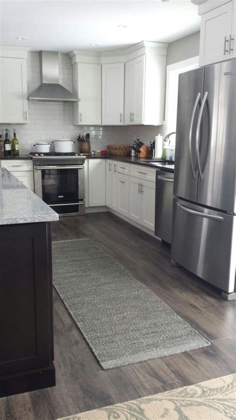 Gray Kitchen Floor by 25 Best Ideas About Grey Wood Floors On Grey