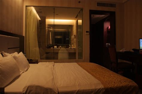 hotels with bathtub in room hotel room with glass to bathroom photo