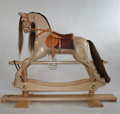 hand carved wooden rocking horses