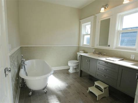Chic bathroom with tan walls paired with gray subway tile backsplash