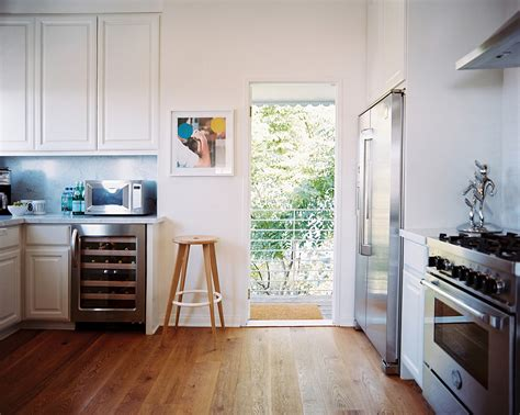 white kitchen with stainless steel appliances stainless appliances photos design ideas remodel and