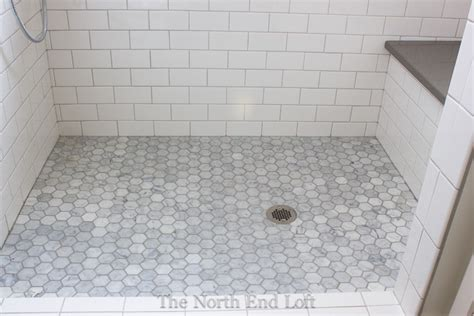 bathroom floor tile grout the shower floor is hexagon shaped marble tiles with