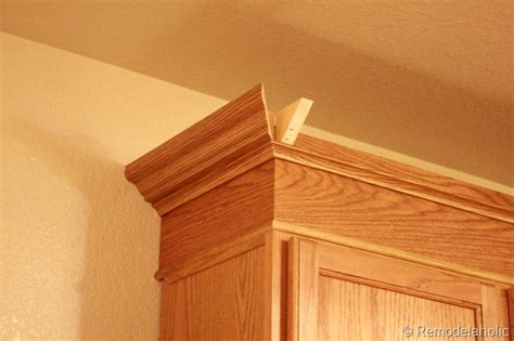 crown molding on top of kitchen cabinets update builder grade cabinets fast without painting